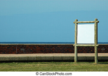 Blank sign - A big white blank sign on wooden poles standing...