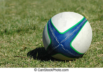 Rugby ball - A white, green and blue used real Rugby ball...