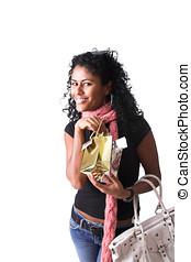 Happy shopper - Happy brazilian girl with little shopping...