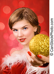 christmas girl holding a toy in her hand