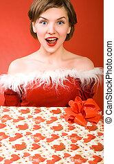 christmas girl holding a gift box