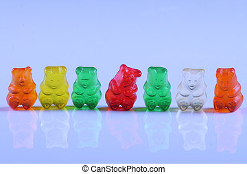 Gummy bears in row - Colorful gummy bears lined up in rows,...