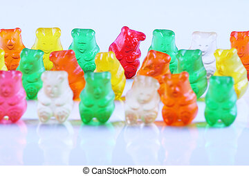 Gummy bears in rows - Colorful gummy bears in rows, focus on...