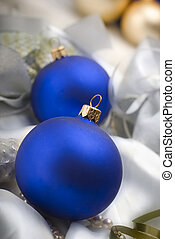 christmass - blue christmass ornaments on silk close up...