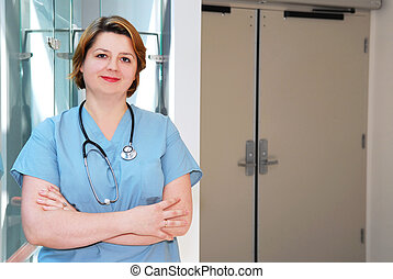 Nurse in a hospital - Portrait of a smiling nurse in a...