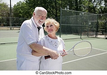 Senior Mixed Doubles - Senior man gives his wife pointers on...