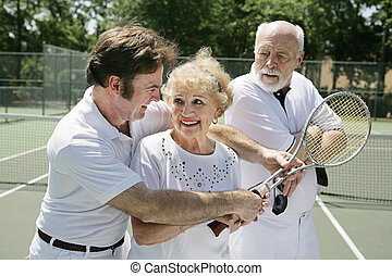 Tennis Lessons - Jealous Husband - Senior lady taking tennis...