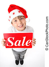 Standing boy holding sale sign