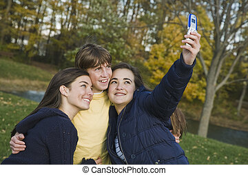 Teens - Three caucasian teens one male and two females...