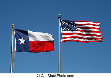 Texas and US Flag - A Texas and US flag boldly flapping in...