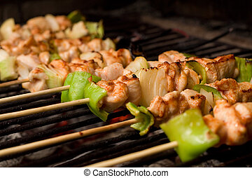 Barbecue on wooden sticks - Barbecue on sticks - meat and...