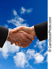 Handshake - A business hand shake on a summer clouds...