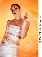 Plastic Wrap - Beautiful young woman wearing plastic wrap.