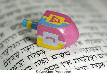 Dreidel with Gelt and a Hebrew Bible - Passover Related