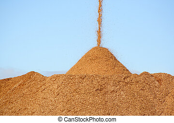 Wood chips - Pile of pouring wood chips