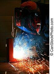 Welding - Worker in a workshop welding steel