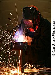 Welding - worker welding steel