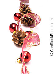 christmas ornaments on white background: ribbon, cones and...