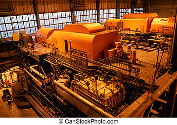 steam turbine and different size and shaped pipes at a power...