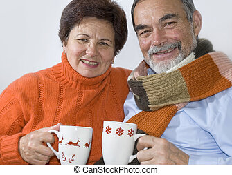 elderly couple  - Happy elderly couple is drinking hot tea