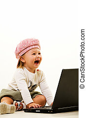 Baby computer genious - Adorable caucasian baby girl toddler...