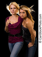 Girlfriends - Portrait of a two young attractive women in...