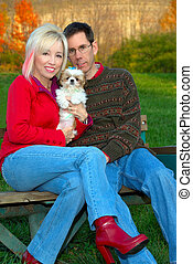 Family Outing in the Fall - A married couple and their Shih...