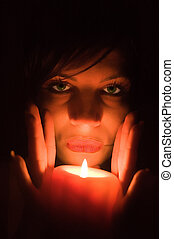 Portrait with candle - Portrait a young sensual girl with...