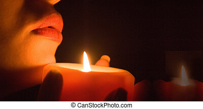 Close up of woman\\\'s lips of candle light, DOF is shalow