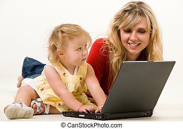 Mom and baby with laptop - Adorable baby girl toddler...