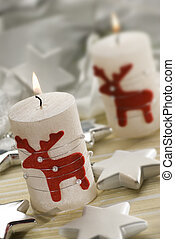 candles - christmas candles with small figures close up