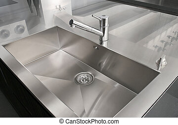 Kitchen sink - Angle view of kitchen sink and silver faucet