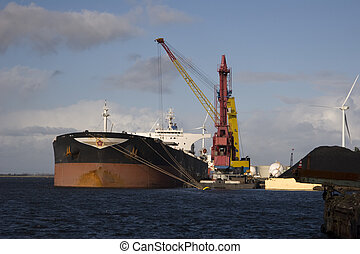 unloading - ship in the harbour