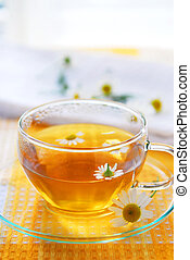 Camomile tea - A teacup with soothing herbal camomile tea