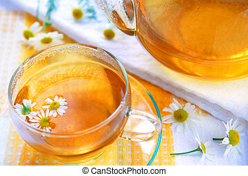 Camomile tea - Teacup and teapot with herbal soothing...