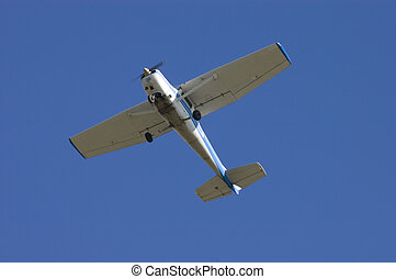 Private aircraft - aircraft flying overhead after takeoff in...