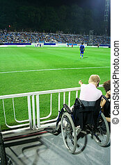 Invalid on the stadium, sport event - Invalid in wheelchair;...