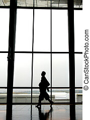 Traveller at an airport, walking to next gate