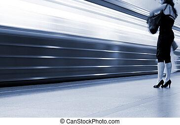 Subway. Underground station, motion blur. Tint blue