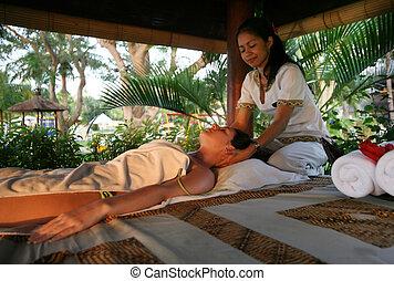 Massage - White woman on massage in Bali salon
