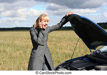 woman with broken car - young blond woman with her broken...