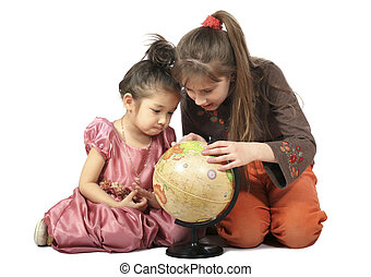 Two girls consider globe - Two girls with long hair slavonic...