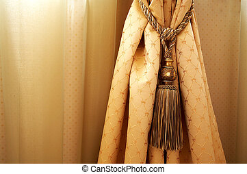 Yellow curtain with ornaments in the modern house
