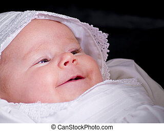 Baby Portrait - A close up on baby girl in a christening...