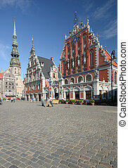 Riga townhall - Main square with Townhall and church in...