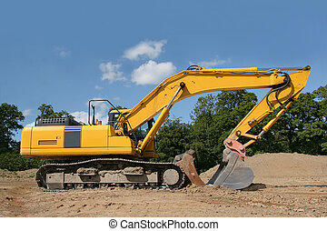 Earthmover - Yellow digger standing idle on a construction...