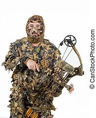 Archery hunter in full camouflage gear