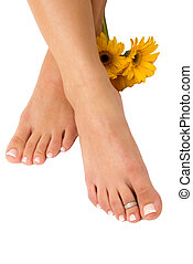 Pedicured Feet - Pedicured feet and yellow daisies