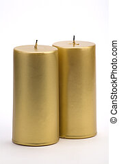 Candles - Two Gold candles against a white background