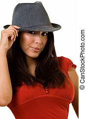 Woman in hat - Head shot of a beautiful Hispanic brunette...